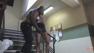 The head of a correctional institution fucks with a black guard on the stairs