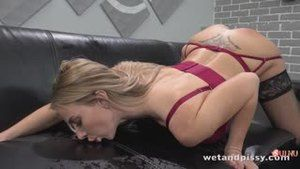 Girl pissing on a sofa during masturbation